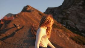 Follow me. Young couple girl is calling for herself woman leading boyfriends hiking on mountains. POV travel concept.