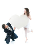 Young couple holding heart shape. Isolated on white background Royalty Free Stock Photos