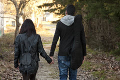 Young couple holding her hand Stock Photos