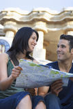 Young Couple Holding Map Stock Photography
