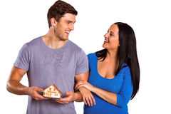 Young couple holding a model house Royalty Free Stock Images