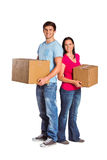 Young couple holding moving boxes Stock Photos