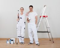 Young Couple Holding Paint Roller Royalty Free Stock Image
