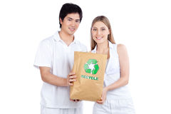 Young Couple Holding Paper Bag Stock Images