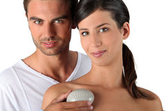 Young couple holding pebble Royalty Free Stock Images