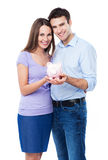 Young couple holding piggy bank Royalty Free Stock Photos