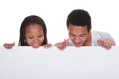 Young couple holding placard Stock Photography