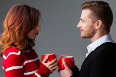 Couple with coffee mags Stock Images