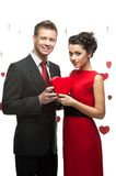 Young couple holding red heart Stock Photo