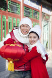 Young couple holding red lantern Royalty Free Stock Photos