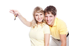 Young couple holding a set of keys Royalty Free Stock Images