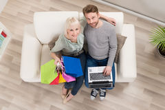 Young Couple Holding Shopping Bag With Laptop Royalty Free Stock Photo