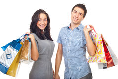 Young couple holding shopping bags. Isolated on white background Stock Photos