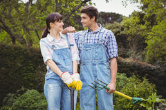 Young couple holding shovel and spading fork Royalty Free Stock Image