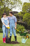 Young couple holding shovel and spading fork Royalty Free Stock Photo