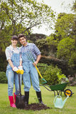 Young couple holding shovel and spading fork Stock Photography