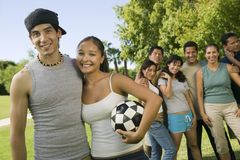 Young couple holding soccer ball Stock Images