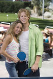 Young Couple Holding Tennis Bats Royalty Free Stock Photo