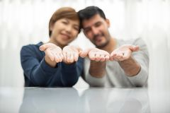 Young couple holding their new dream house. With their hands together royalty free stock images