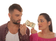 Young couple holding a twenty US dollar bank note Stock Photo