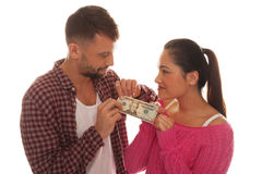 Young couple holding a twenty US dollar bank note Stock Photos