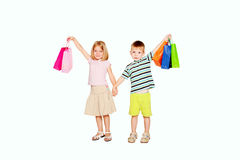 Young couple holding up shopping bags. Royalty Free Stock Images