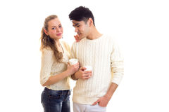 Young couple holding white cups Royalty Free Stock Image