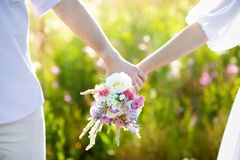 Young couple holding wild flowers bouquet Royalty Free Stock Photo