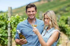 Young couple holding wine bottle and glass Royalty Free Stock Photo
