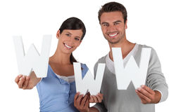 Young couple holding WWW Stock Photography