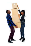 A young couple holds boxes in studio Royalty Free Stock Photo