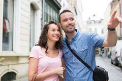Young couple on holidays doing shopping Stock Photo