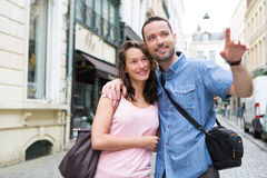 Young couple on holidays doing shopping Stock Images
