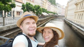 Young couple on holidays taking selfie. Travel concept stock video footage