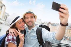 Young couple on holidays taking selfie Stock Image