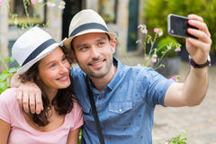 Young couple on holidays taking selfie Royalty Free Stock Photography