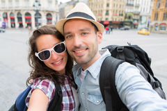 Young couple on holidays taking selfie Stock Images