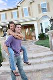 Young Couple at Home. A young man and woman couple in love in front of their new home stock photo