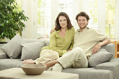Young couple at home stock photos