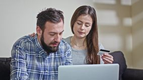 Young Couple at Home Buying on Internet stock footage