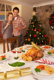 Young couple at home at Christmas Stock Photo