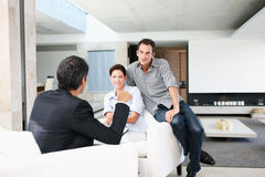 Young couple at home discussion with a agent Stock Photo