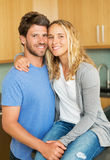 Young couple at home in the kitchen Royalty Free Stock Images