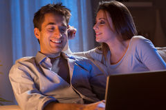 Young couple at home with laptop Royalty Free Stock Image