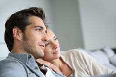 Young couple at home relaxing royalty free stock image
