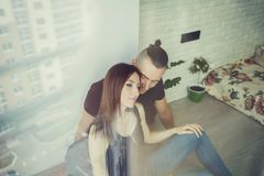 Young couple at home. Sensual indoor portrait of young stylish fashion couple Stock Image