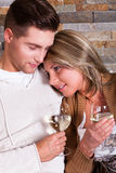 Young couple at home, smiling. With wine glasses royalty free stock images