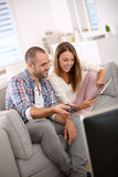 Young couple at home with tablet Royalty Free Stock Images