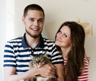 Young couple at home with their cat Royalty Free Stock Photo