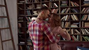 Young couple at home together saint valentine`s day concept at library dancing close. Young couple at home together saint valentine`s day in the library dancing stock video footage
